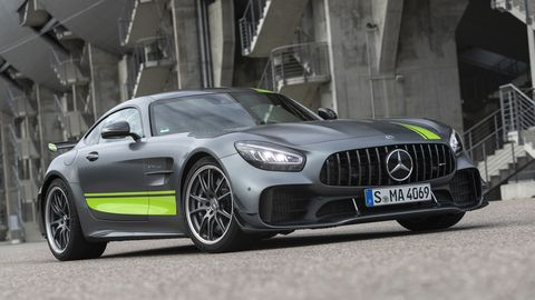 The 2020 Mercedes AMG GT R Pro in grey with a green racing stripe, subtle and loud all at once