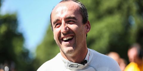 Rubert Kubica enjoys a little downtime at the Goodwood Festival of Speed earlier this month.