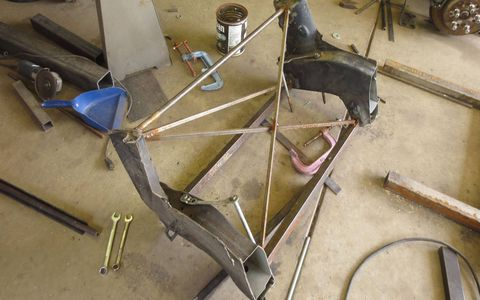 Enough of the Lexus SC400 suspension-donor frame was preserved, with stiffeners welded in place, to make a front suspension jig for the 1941 Plymouth project.