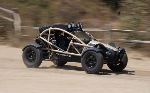 Remember the Ariel Atom? This is its crazy, backwoods, dirt-driving cousin, the Nomad. It weighs 1,680 pounds and has a rear-mid-mounted 230-hp transverse four spinning grippity Geolander tires. Yes, it was fun to drive.