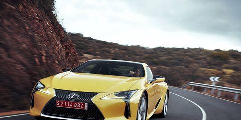 Motor vehicle, Mode of transport, Automotive design, Yellow, Transport, Vehicle, Land vehicle, Automotive lighting, Road, Car,