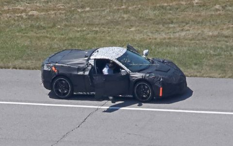 These new spy shots of the mid-engine Corvette show even more detail than before, even as the engineers quickly cover it up after noticing they've been spotted.