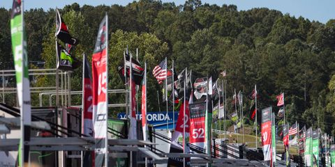 A large crowd of race fans walked the paddock, collecting autographs, buying merchandise and watching teams make final preparations before the running of Motul Petit Le Mans on Saturday.