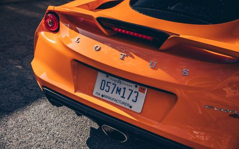 Mode of transport, Automotive design, Vehicle registration plate, Yellow, Vehicle, Automotive tail & brake light, Automotive lighting, Automotive exterior, Car, Orange,
