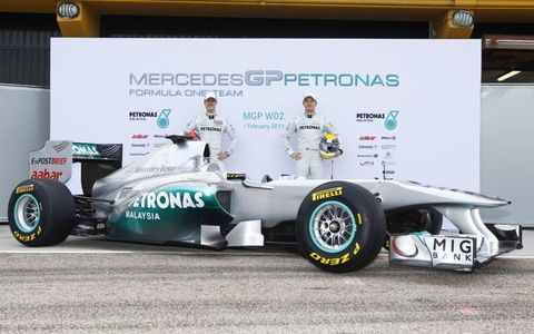 Mercedes drivers Michael Schumacher and Nico Rosberg with the new MGP W02