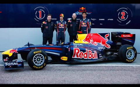 Christian Horner and Adrian Newey join their drivers next to the new Red Bull RB7
