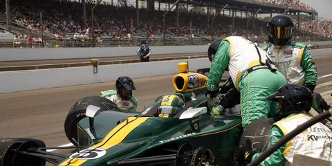 In 2010, Takuma Sato wore a helmet celebrating Lotus and Jim Clark's 1965 Indy 500 victory.