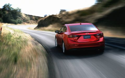 The Mazda 3 continues to offer a sporty feel, but it's not held back by some of the compromises that the Miata has to contend with, making it an easier all-weather car to live with.