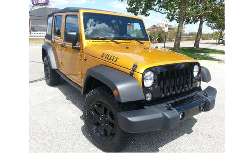 The 2014 Jeep Wrangler Unlimited Willys Wheeler comes in at a base price of $27,190 with our tester topping off at $34,880.