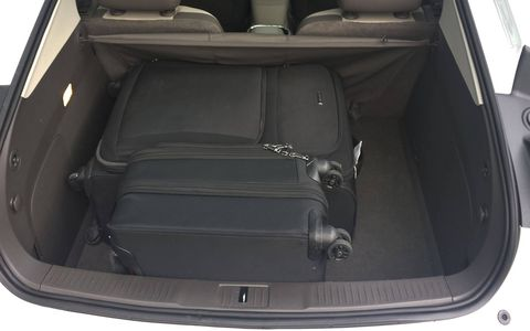 The trunk has room for a couple of suitcases.