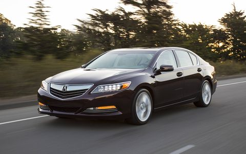 Producing a combined 377 horsepower and 341 lb-ft of torque, the 2014 Acura RLX Sport Hybrid is powered by a direct injected 3.5-liter V6 engine and a three-motor hybrid system.