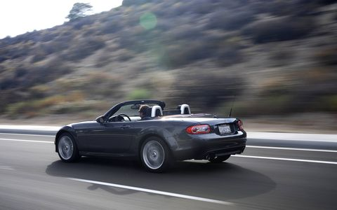 Frugal top-down summer driving at its finest...give or take a few compromises.
