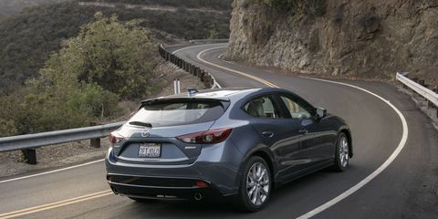 The 2015 Mazda 3 s Grand Touring 5-Door is equipped with a 2.5-liter I4 coupled with a six-speed manual gearbox.