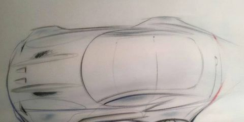 A bird's-eye view of Henrik Fisker's drawing board, showing one of the two cars he will debut in Detroit. Fisker promises it'll be an American supercar.
