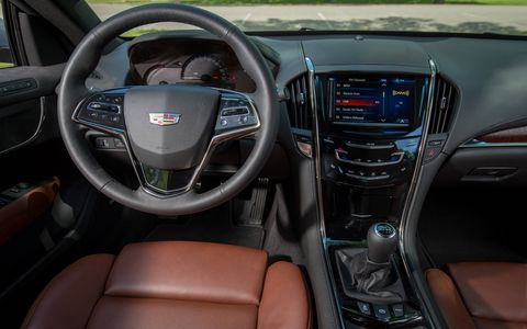 The seats in the 2015 Cadillac ATS 2.0T Performance Coupe are not aggressive, but the bolstering is good enough for this luxury sport combo.