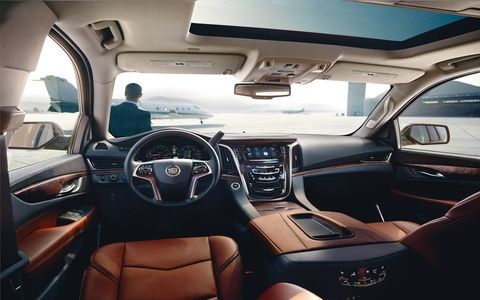 The 2015 Cadillac Escalade ESV Luxury is a much fancier version of the Chevrolet Suburban, and the interior showcases higher-end materials throughout.
