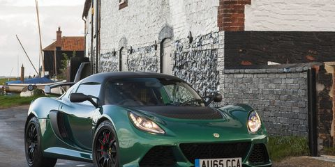 Despite being a radically styled car, the Lotus Exige looks humble in green.