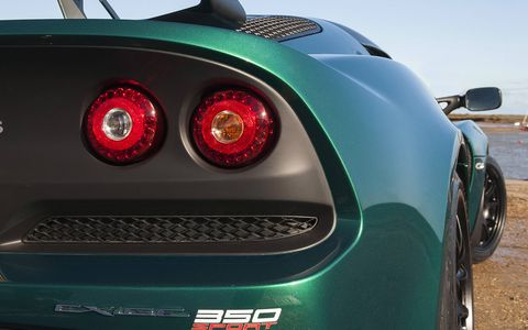 The four round tail lights carries over from the other Exige models, and we're not mad about it.