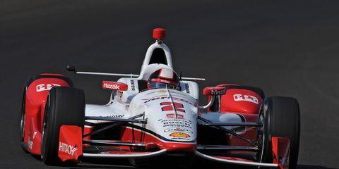 Juan Pablo Montoya powers his Chevrolet at Indianapolis on Sunday.