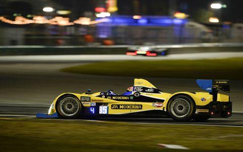 The Oreca FLM09 of drivers Stephen Simpson and Mikhail Goikhberg rolls through practice on Thursday night at Daytona.