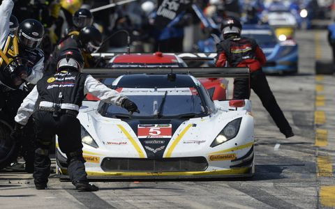 The Action Express Racing Corvette DP comes in for service at Sebring on Saturday.