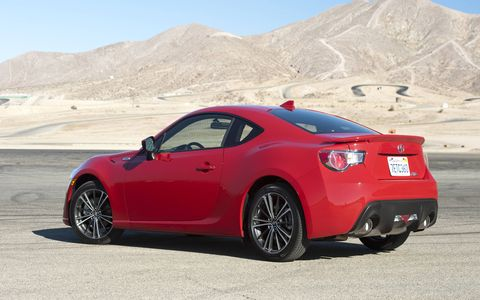 The FR-S gets a sleeker antenna on the roof and larger exhaust tips that actually look like they fit the bumper.