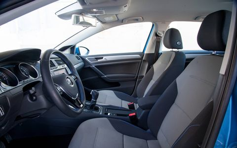 Bright blue stitching in the interior of the 2015 Volkswagen e-Golf is another reminder that it's an electric car. (Limited model shown)