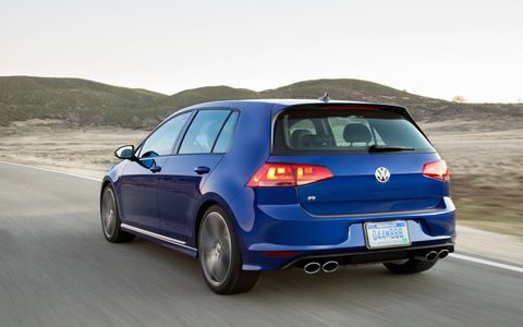 "Rear-end details that define the new Golf R include an ""R"" design diffuser, the four chrome tailpipes, and an ""R"" logo on the hatch."
