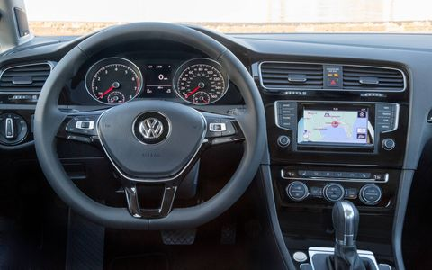 The interior of the 2015 Volkswagen Golf 1.8T S 4-Door is a class-act. Automatic transmission shown.