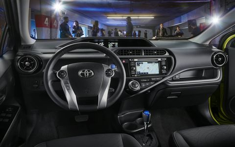 The c features a SofTex trimmed steering wheel and color-keyed heated power outside mirrors with turn signal indicators.