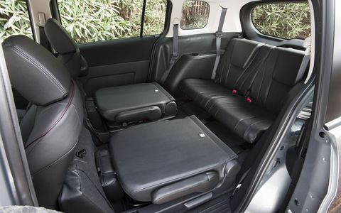 The Mazda 5 Grand Touring has multiple storage compartments, including under-seat storage in the second row, which can be easily accessed by folding the seat-bottom cushions up.