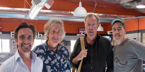 """The stars of """"The Grand Tour"""" -- from left, Richard Hammond, James May and Jeremy Clarkson -- stopped by to visit Adam Carolla's podcasting home base in California."""