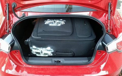 The FR-S trunk actually fits my large suitcase, which is impressive for a small car.