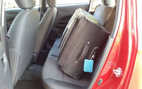 The trunk won't fit my big suitcase and my camera bag, so into the back seat it went.