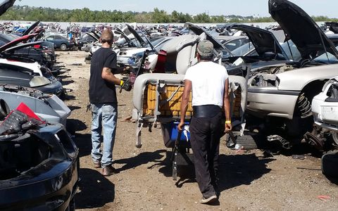 Using a bench seat to stack parts is a common strategy at the All You Can Carry Junkyard Sale.