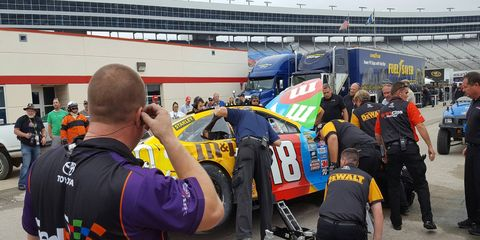 Joe Gibbs Racing works to salvage the Kyle Busch primary car on Friday at Texas Motor Speedway