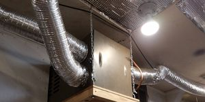 I built a furnace shelf, supported by ceiling-mounted chains, and rigged up clothes-dryer ducting for heat vents.