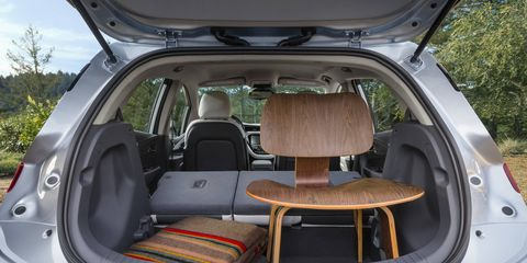"""""""Floating"""" instrument panel and multipurpose, connected center console – offers wireless phone charging and a compartment large enough to stow a tablet device."""