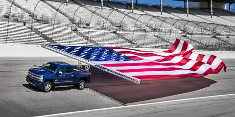 To prove the Duramax-equipped 2017 Chevrolet Silverado 2500HD has grunt, Chevy hooked a 40-by-80 foot United States flag to the back of one and towed it around the Texas Motor Speedway to set a Guinness word record and prove American is number one.