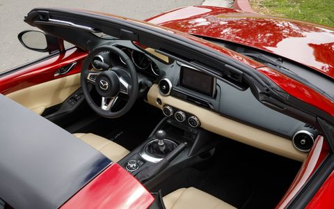 The RF is everything we liked about the soft top Miata in a package that's easier to live with.