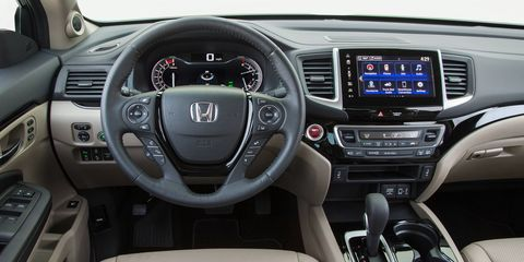The top Ridgeline comes with tri-zone climate control, push button start, a full-color TFT center meter and available 8-inch display audio touchscreen with Apple Car Play and Android Auto compatibility.