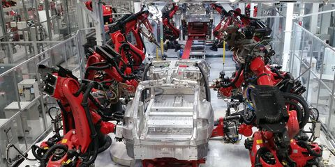 As befits a car assembly plant located in Silicon Valley's sphere of influence, robots are everywhere in the Tesla Plant.