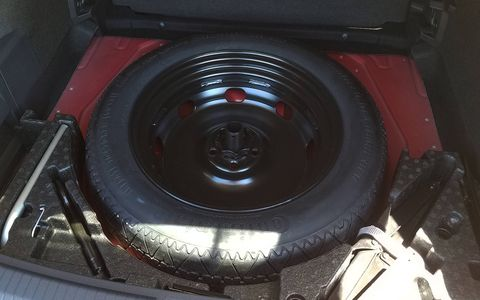 You get a spare tire under the cargo area, though it is of the space-saver variety.