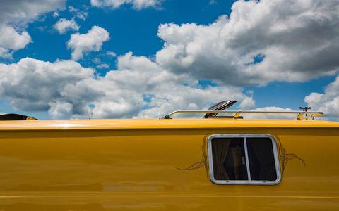 Sky, Yellow, Daytime, Cloud, Natural environment, Vehicle, Automotive exterior, Landscape, Cumulus,