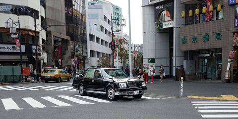 Curtains closed while gliding silently through Shibuya, Tokyo.