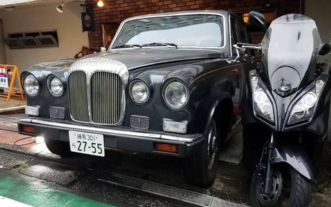 This late-1960s/early-1970s Daimler Sovereign (based on the Jaguar XJ6) appears to be associated with a French-themed basement bar. Britain, France, what's the difference?