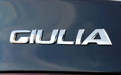 Vehicle, Car, Logo, Emblem, Trademark, Hybrid vehicle, Pickup truck,