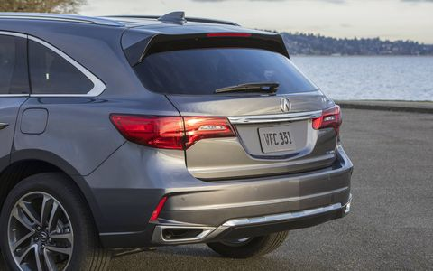 The new front end is very stylish, some might say busy, with jewel eye-style headlights and fog lights, a huge Acura logo and a grille that brings your eyes right to it. We'd say the last model was restrained in front, this one is anything but.