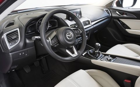 The 2017 Mazda 3 Grand Touring gets perforated leather seats, full-color active driving head-up display, an analog tach and digital speedometer.
