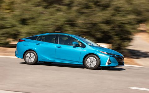 The Prius Prime is a plug-in hybrid version of the Toyota Prius that can go 25 miles on a charge thanks to a bigger, much bigger, 8.8-kWh battery. It achieves 55 mpg city, 53 highway and 54 combined, for a total range of 640 miles. Still looks like and drives like a Prius, though. You can't have everything.